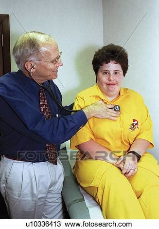 Woman with a disability undergoing a routine physical