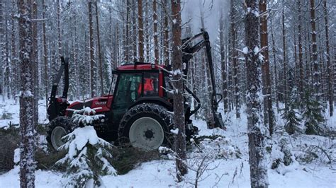 Valtra A93 harvester with Nisula 325H